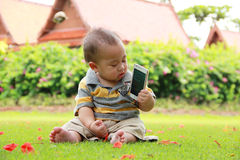 Baby play with phone. Baby boy play with moblie phone alone Royalty Free Stock Photo