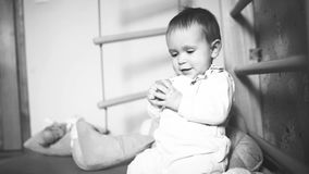 Baby play photo sequence. Baby play with toys, video from BW photo sequence stock video footage