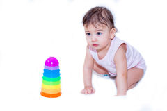 Baby play with a piramide. Baby play with a color piramide Stock Photos