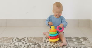 Baby play with pyramid stock video footage