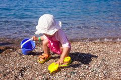 Baby play on seashore stock image