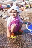 Baby play on seashore stock photography