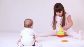 Baby play with sister stock video footage