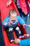 Baby play on slide Royalty Free Stock Photo
