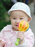 Baby play with a toy. A chinese baby play with a toy Royalty Free Stock Photo
