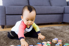 Baby play with toy block Stock Photo