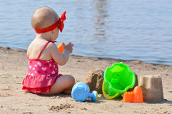 Baby play toys on beach Royalty Free Stock Image