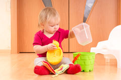 Baby play with toys on floor Royalty Free Stock Photos