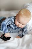 Baby play with TV remote Royalty Free Stock Photos