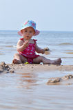 Baby play in the water Stock Photography