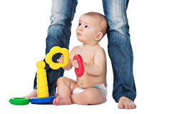 Baby play on white background with mother. Baby play with toys on white background with mother Royalty Free Stock Photo