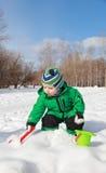 Baby play winter Stock Image