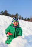 Baby play winter. Little boy playing in winter snow Royalty Free Stock Photo