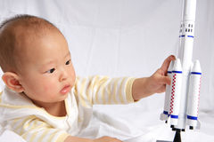 Baby Play With Rocket Model Royalty Free Stock Image
