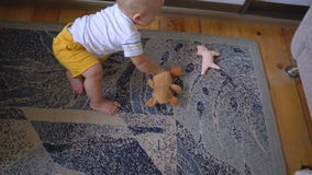 Baby is played with a toy. Hd stock video footage