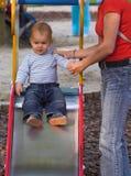 Baby on the playground Stock Photo