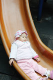 Baby in the Playground Stock Image
