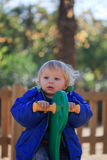 Baby on playground. Happy baby on rock horse in playground Stock Image