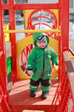 Baby on playground. In winter Royalty Free Stock Images