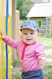Baby on playground. Baby age of 10 months on playground Stock Photo