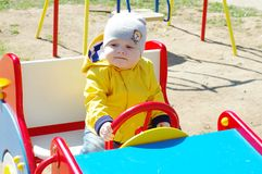 Baby on playground Stock Photo