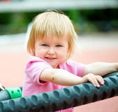 Baby on playground Stock Photos