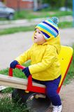 Baby on playground. Happy baby playing on playground Stock Images