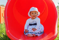 Baby in a Playground Stock Photography