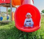 Baby in a Playground Stock Photo