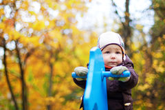 Baby on the playground. Baby plays on the playground alone in autumn Stock Photo