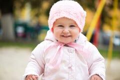 Baby on the playground Stock Image