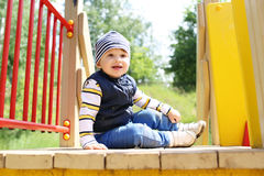 Baby on playground in summer Stock Photo