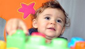 Baby playing stock photography