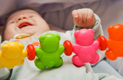 Baby is playing. The baby is playing with his toys Stock Image