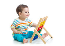 Baby playing with abacus Royalty Free Stock Images