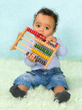 Baby playing with abacus Stock Images