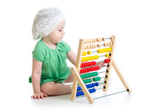 Baby playing with abacus Royalty Free Stock Image