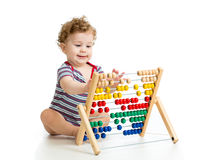 Baby playing with abacus toy. Concept of early Royalty Free Stock Photography