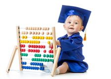 Baby playing with abacus toy. Concept of early Royalty Free Stock Image