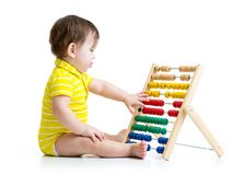 Baby playing with abacus toy. Concept of early Stock Photography