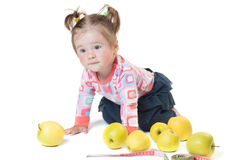 Baby playing with apples isolated Stock Images