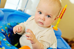Baby playing in baby jumper. Funny baby playing in the baby jumper Royalty Free Stock Photos
