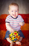 Baby  playing with a ball. Baby boy playing with a ball on the floor Stock Image