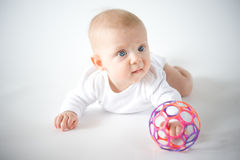 Baby playing with ball Royalty Free Stock Photo