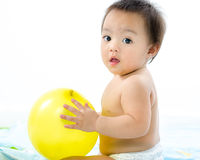 Baby playing balloon. Stock Photography