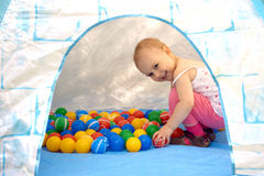 Baby playing with balls Stock Image
