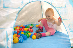 Baby playing with balls Royalty Free Stock Photos