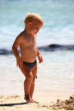 Baby playing on beach Stock Photography