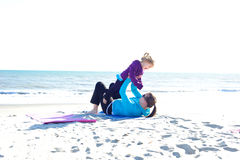 Baby playing at beach. Baby and mother playing at the beach Stock Photo