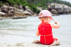 Baby playing on beach with copy space during summer holidays. Child playing on beach with copy space during summer holidays Royalty Free Stock Photography